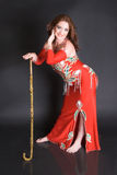 Belly Dancer with cane. Belly dancer with tribal cane decorated in gold royalty free stock image