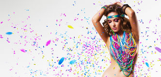 Belly dancer in colourful nacklace with petals Royalty Free Stock Photo