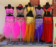 Belly dancer costumes on stands Royalty Free Stock Photos