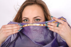 Belly dancer covers her face Stock Images