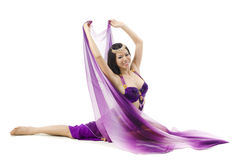 Belly dancer dancing on floor Royalty Free Stock Photography