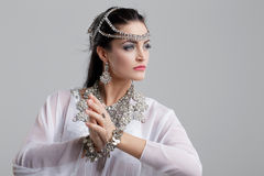 Belly dancer dancing on grey background. Young belly dancer woman dancing on grey background Stock Photos