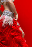 Belly dancer. An Elegance red dress Belly dancer girl in action. With Red background Stock Photos