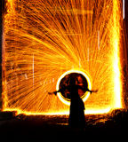 Belly dancer on fire. Belly dancer silhouetted by fire in a tunnel Stock Image