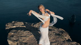 Belly dancer girl on the rock in Crimea near Black stock footage
