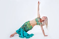 Belly  dancer in a green dress. Stock Image
