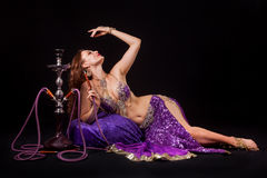 Belly dancer with hookah Royalty Free Stock Photography