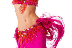 Belly dancer in a hot pink costume shaking her hips
