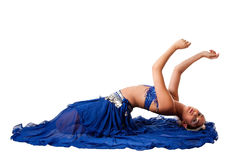 Belly dancer laying backwards. Beautiful Israeli Egyptian Lebanese Middle Eastern belly dancer performer in blue skirt and bra with arms in air laying bending stock images