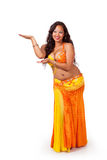 Belly dancer making presenting gesture Stock Photo