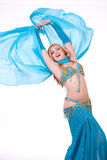 Belly dancer moving blue veil behind her Stock Image