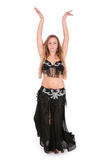 Belly dancer performing with her hands up Stock Photography