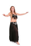 Belly dancer performing with her hands up Royalty Free Stock Image