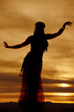 Belly dancer purple silhouette facing Stock Photos