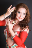 Belly Dancer in Red. Belly Dancer wearing a red costume with jewelery stock photo