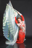 Belly Dancer in Red. Blue eyed belly dancer with a big wings stock photos