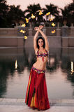 Belly Dancer in Red Costume with Fire Fans Stock Images