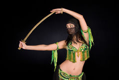 Belly dancer with saber. Oriental belly dancer with saber Stock Photography