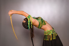 Belly dancer with saber Royalty Free Stock Images
