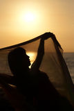Belly dancer silhouette. Silhouette take of an oriental dancer  at sunrise Stock Images