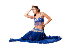 Belly dancer sitting in blue dress Stock Photos