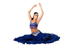 Belly dancer sitting on floor Stock Photo