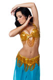 Belly dancer wearing a gold and blue costume Royalty Free Stock Photography
