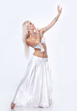 Belly  dancer in a white dress. Stock Photos