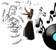 Belly dancer in a world of music Stock Photos