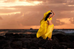 Belly Dancer in Yellow Costume on the Beach at Sunrise Royalty Free Stock Photos