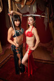 Belly Dancers Holding Swords Stock Photo