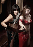 Belly Dancers Holding Swords Stock Image