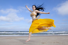 Belly Dancing on the Beach. Beautiful belly dancer dancing on the beach Stock Images