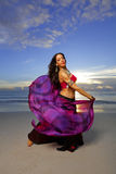 Belly dancing on the beach Stock Image
