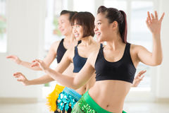 Belly dancing. Young women performing belly dance in a dance studio on the foreground Royalty Free Stock Images