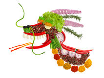Belly dragon. A food concept of a dragon made of spices isolated on white Stock Photography