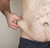 Belly fat being pinched Stock Photography