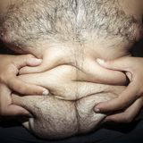 Belly fat and hairy man Stock Images