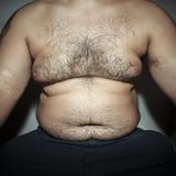 Belly fat and hairy man. With hands Stock Photos