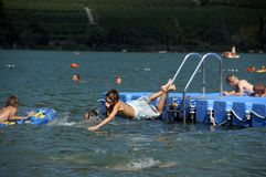 Belly flop 1 2006. Children swimming in the bathing lake; boy during a belly flop; summer 2006; south tyrol stock images