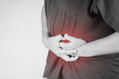 Belly injury in humans .belly pain,joint pains people medical, mono tone highlight at belly.  Stock Photos