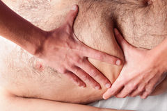 Belly massage Stock Photo