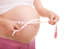 Belly of pregnant woman  measurement of tape Stock Photos