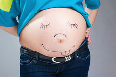 Belly of pregnant woman Stock Images