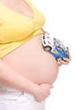Belly pregnant woman with toy spotr car Stock Images