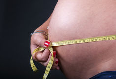 Belly of pregnant women with  measure Stock Photography