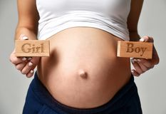 Belly of pregnant women with sign expectation girl or boy Stock Photography