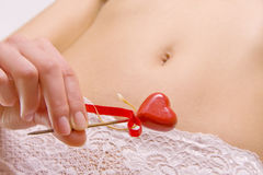 Belly with red heart Royalty Free Stock Photography