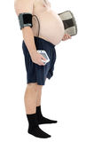 Belly, weight scales and blood pressure meter. Obese man stands with weight scales and blood pressure meter in hands Stock Photography