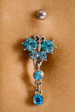 Bellybutton piercing Stock Photo